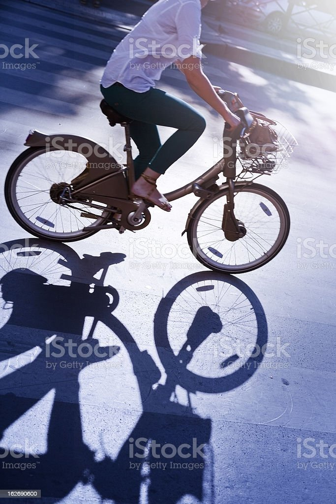 Woman on a rental bike in Paris royalty-free stock photo