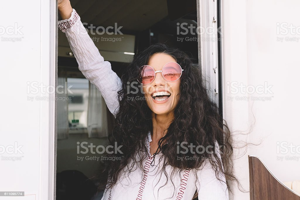 Woman on a road trip with campervan stock photo