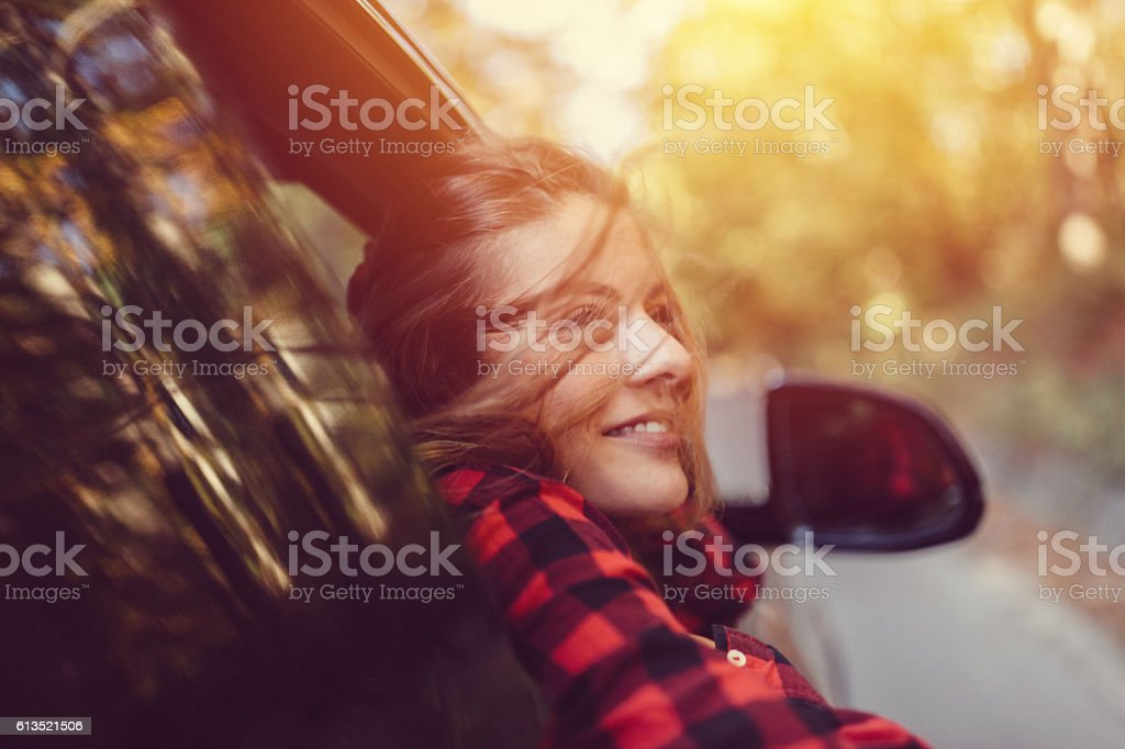 Woman on a road trip with car stock photo