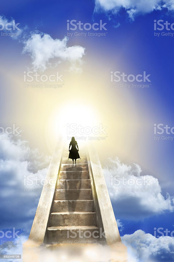 Woman On A Stairway To Heaven stock photo