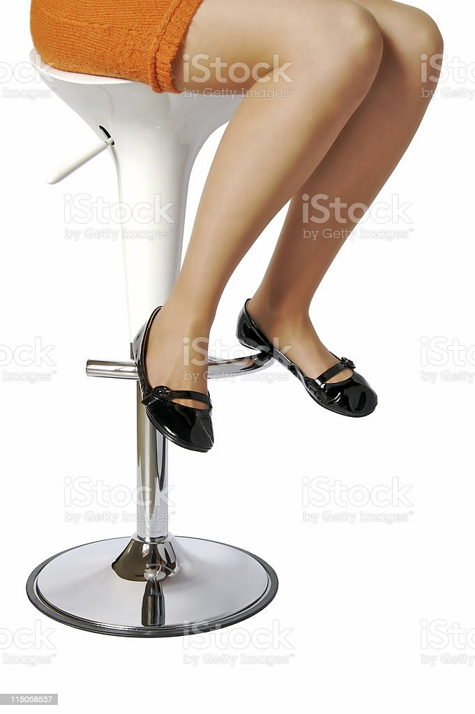 Woman on a stool stock photo