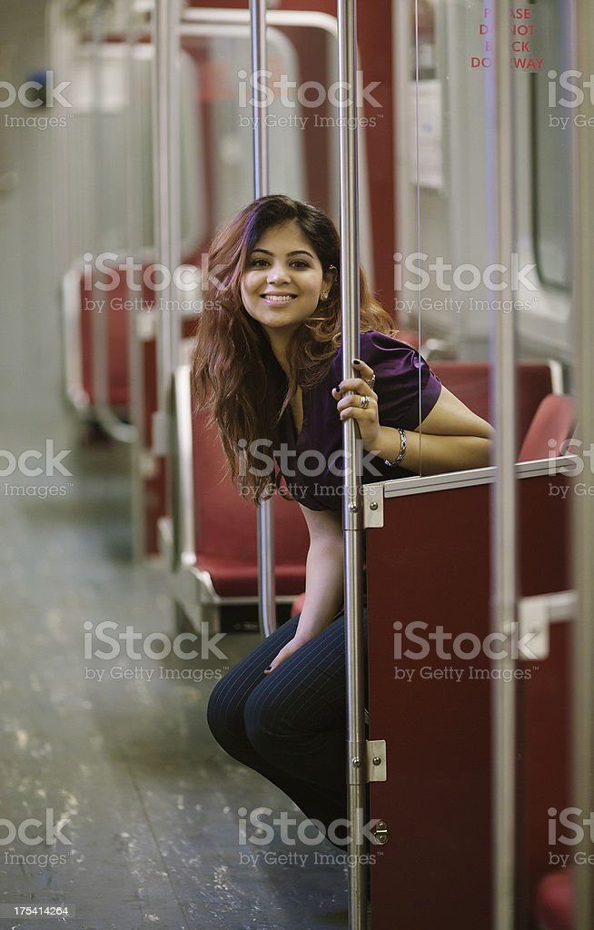 woman on a subway train stock photo