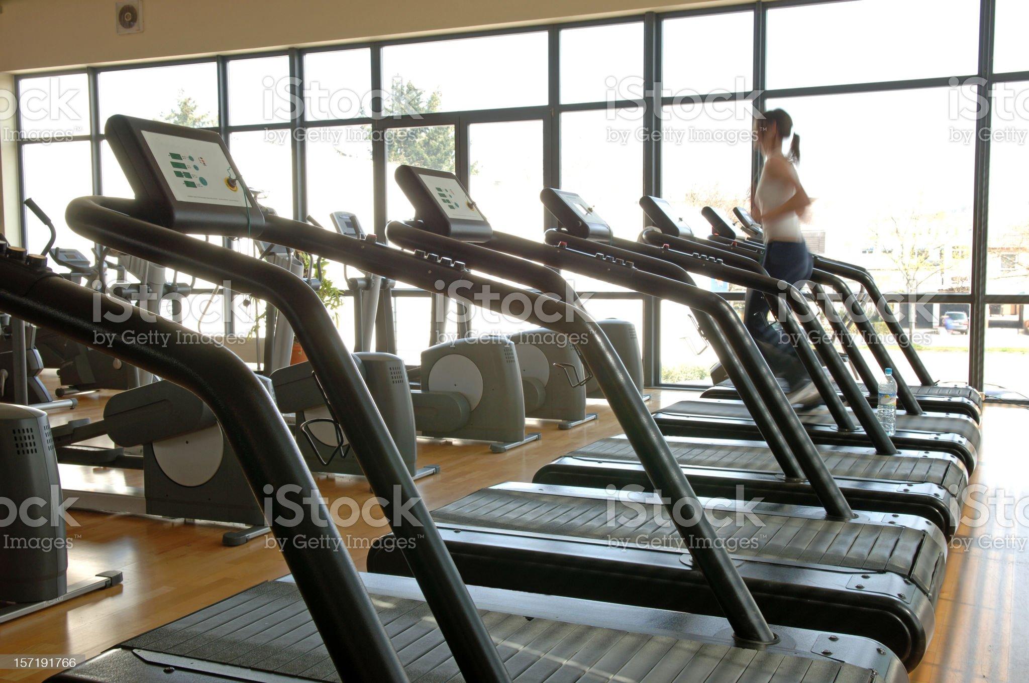 Woman on a treadmill #2 royalty-free stock photo