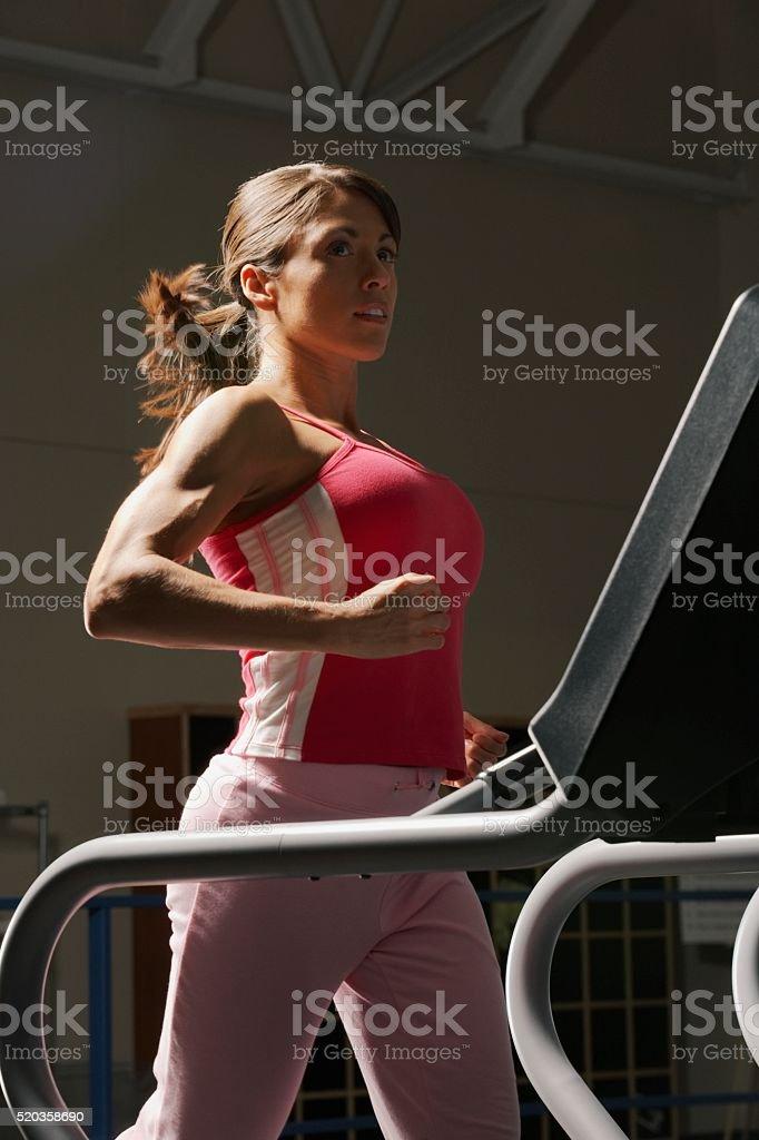 Woman on a treadmill stock photo