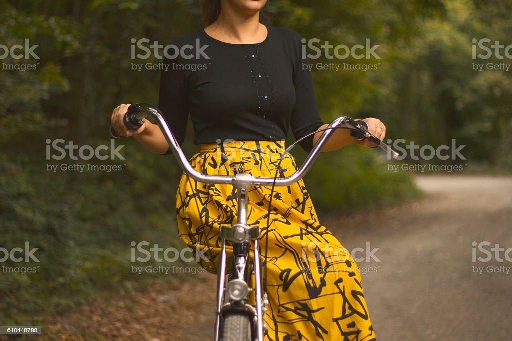 Woman on a vintage bike stock photo