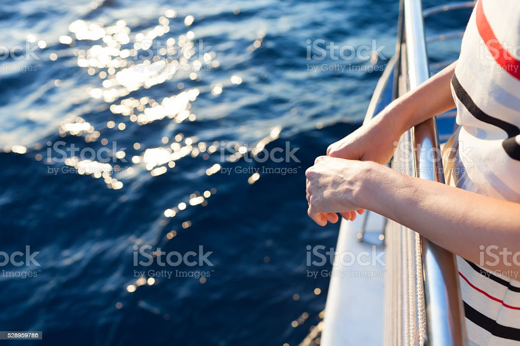 Woman on a yacht during sunset stock photo