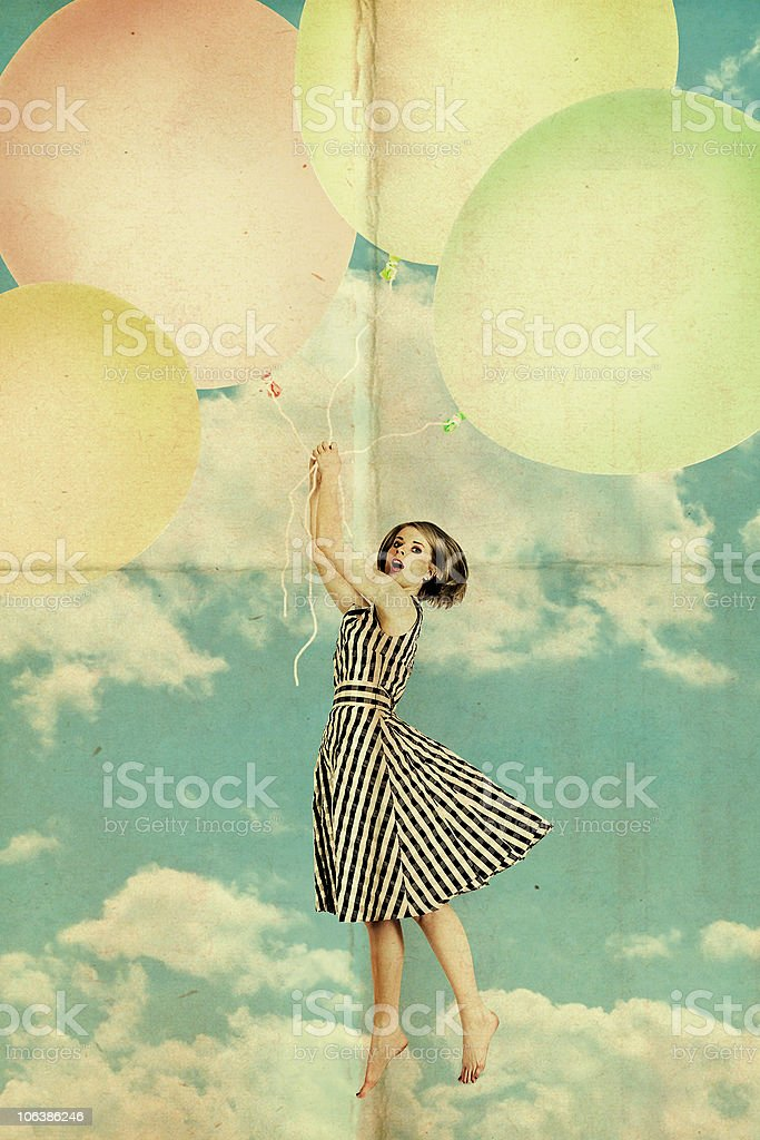 woman on air balls in blue sky with clouds stock photo