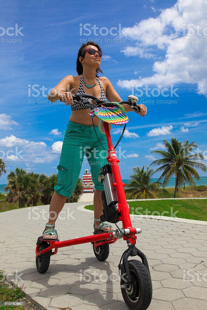 Woman on an electric tricycle in Miami stock photo
