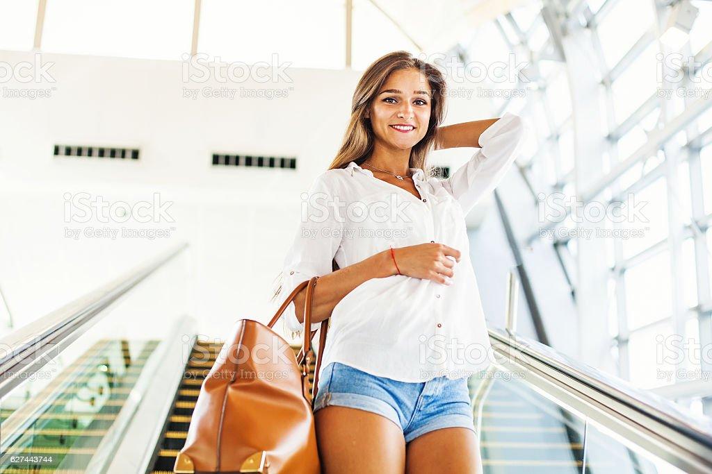 woman on an escalator stock photo