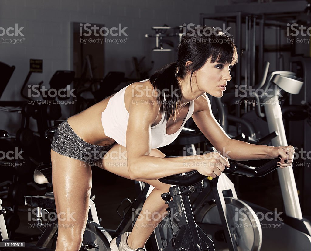Woman On An Exercise Bike stock photo