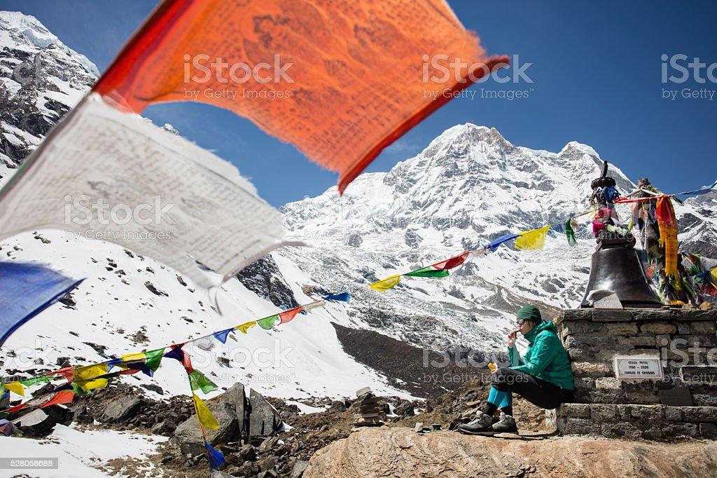 Woman on Annapurna base camp trekking stock photo
