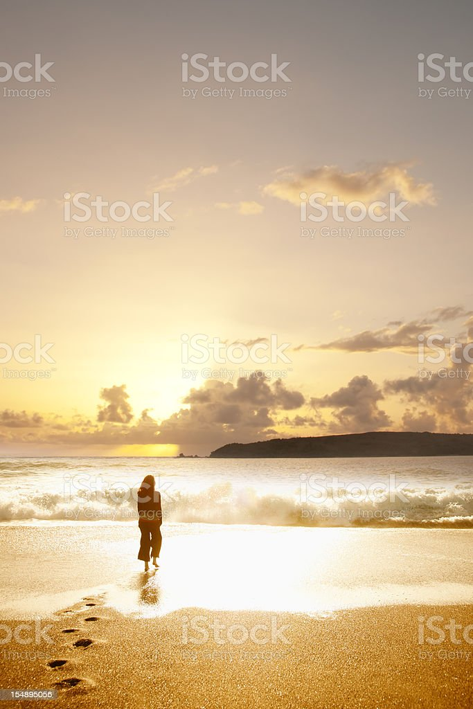 Woman on beach at sunset royalty-free stock photo