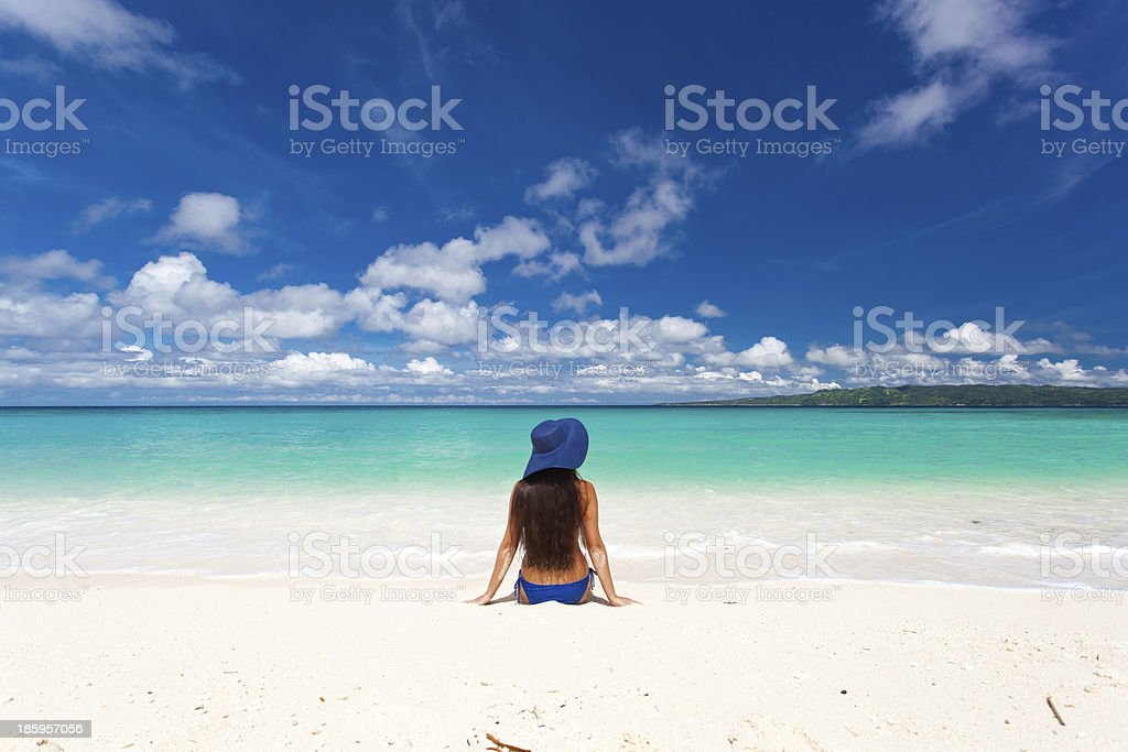 Woman on beach in summer hat royalty-free stock photo