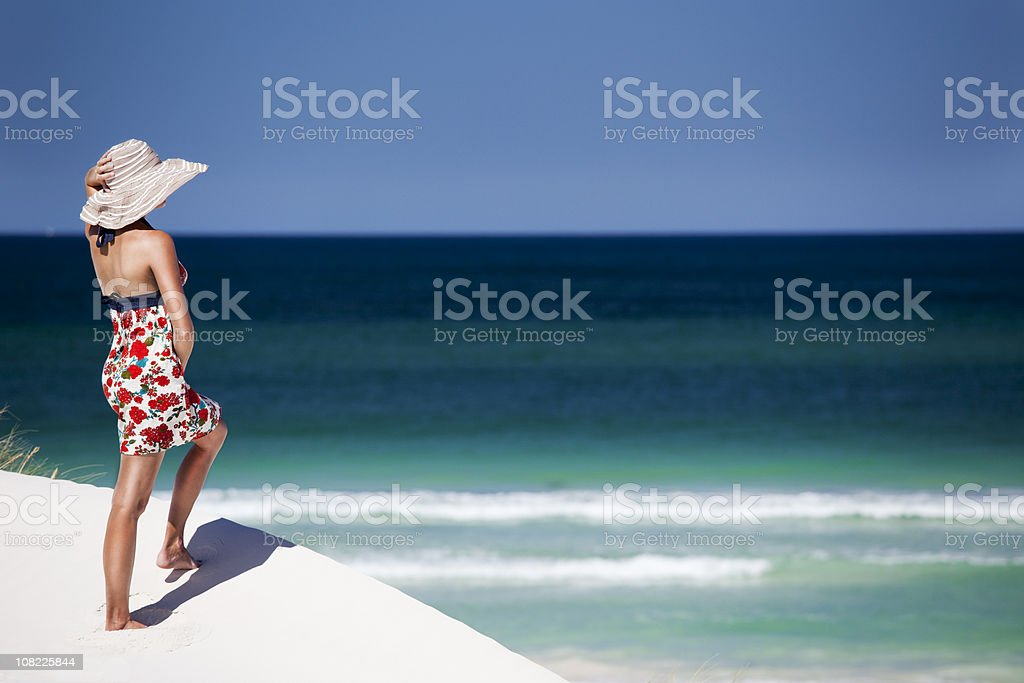 Woman on Beach Looking Out royalty-free stock photo