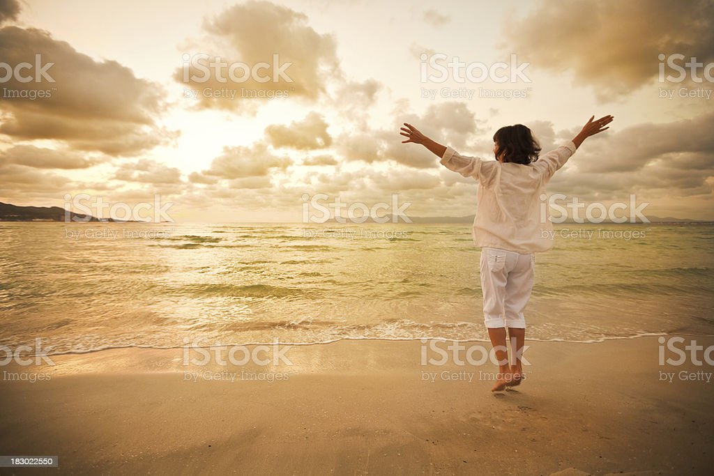 Woman on beach royalty-free stock photo