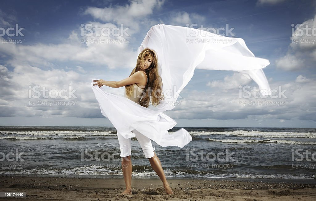 Woman on Beach with White Fabric royalty-free stock photo
