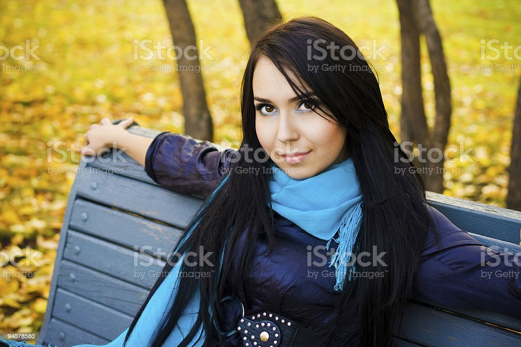 woman on bench in autumn royalty-free stock photo