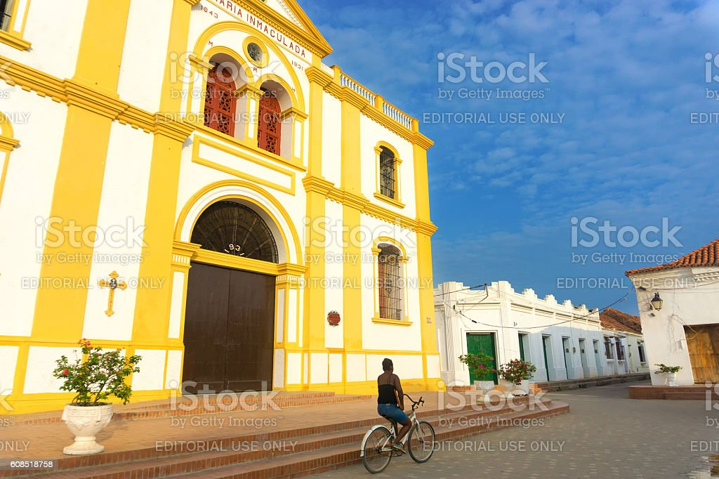 Woman on Bicycle in Mompox stock photo