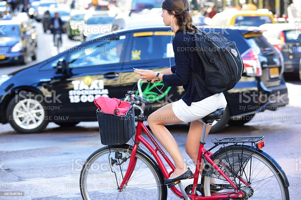 Woman on bicycle in profile stock photo