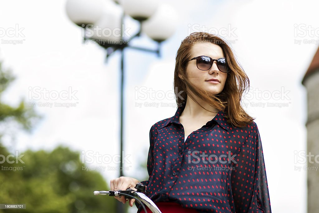Woman on bicycle in sunglasses royalty-free stock photo