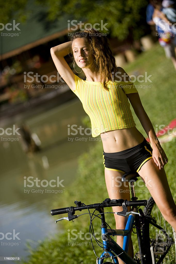 Woman on bicycle royalty-free stock photo