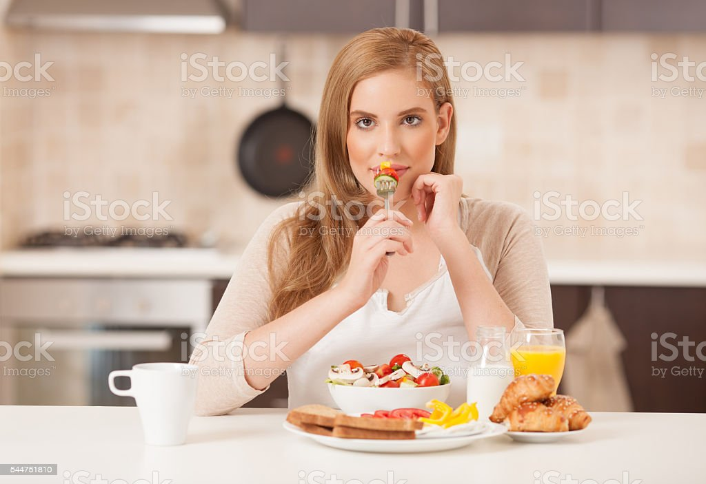 Woman on breaking diet. stock photo