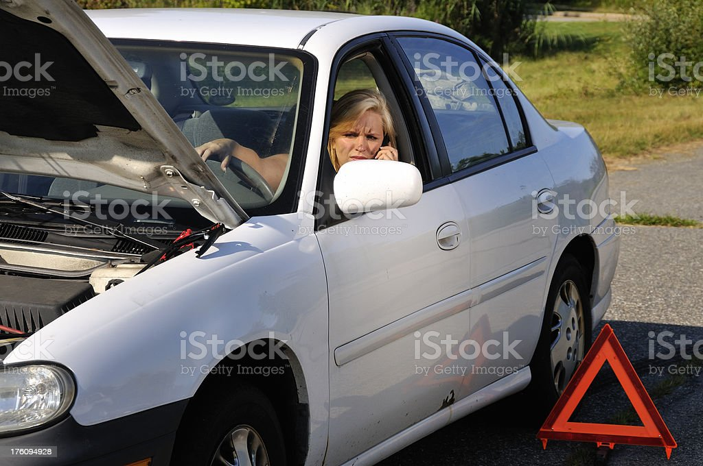 Woman on Cell Phone in Broken Down Car royalty-free stock photo