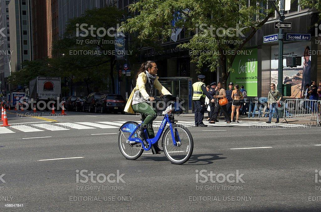 Woman on Citi Bike, E.42nd Street, Midtown Manhattan, NYC royalty-free stock photo