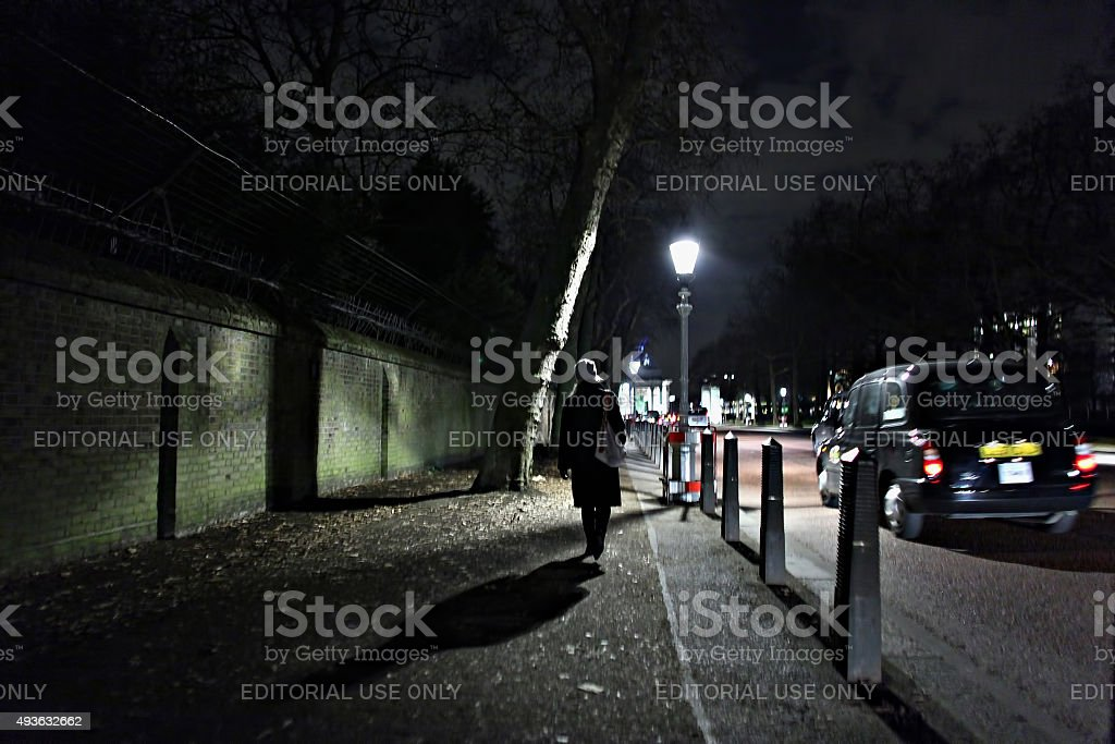 Woman on Constitution Hill at night stock photo