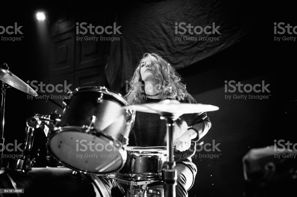 Woman on drums stock photo