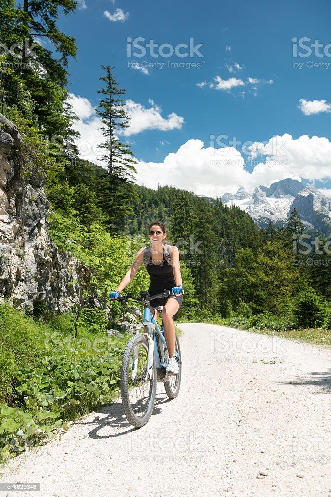 Woman on E-Bike Mountainbike in Nature, Dachstein Glacier, Austrian Alps stock photo