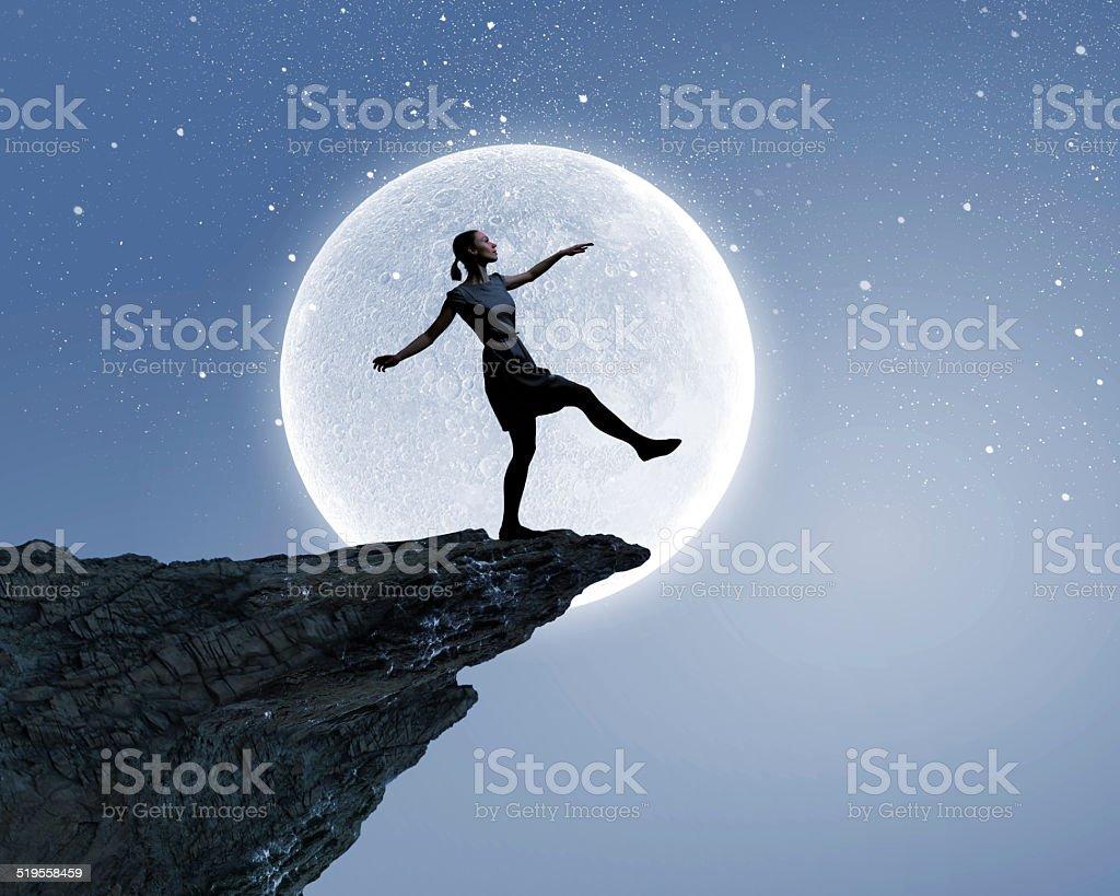Woman on edge stock photo