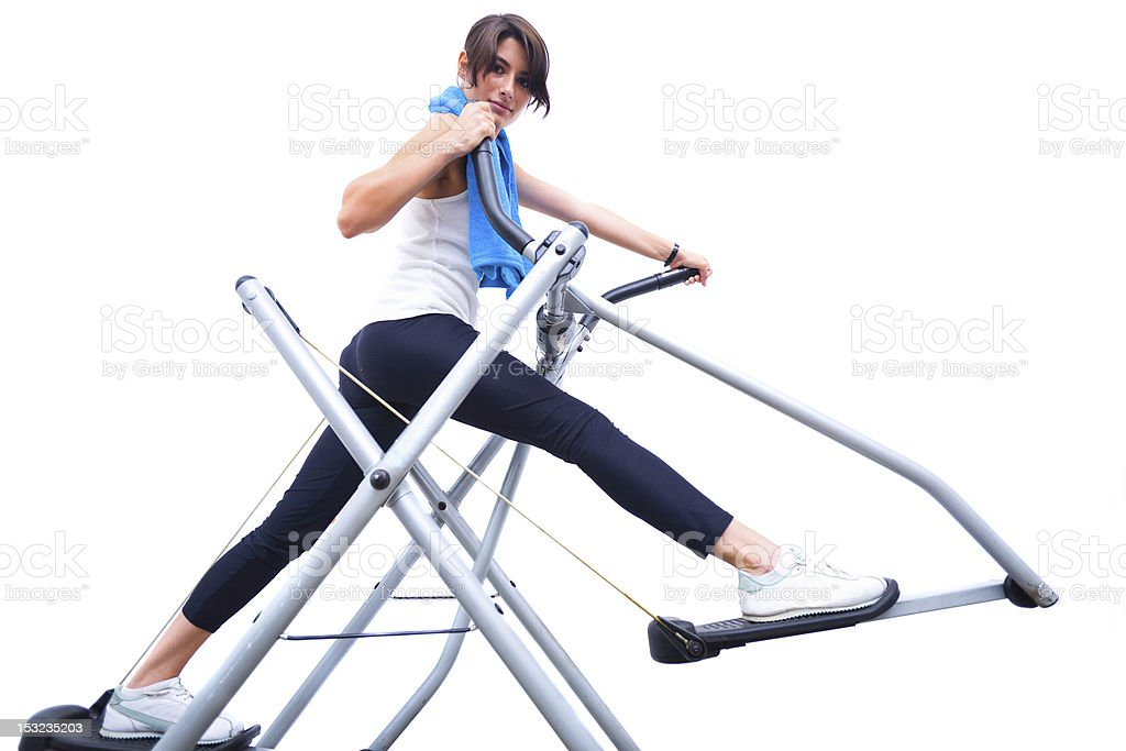 Woman on elliptical stepper royalty-free stock photo