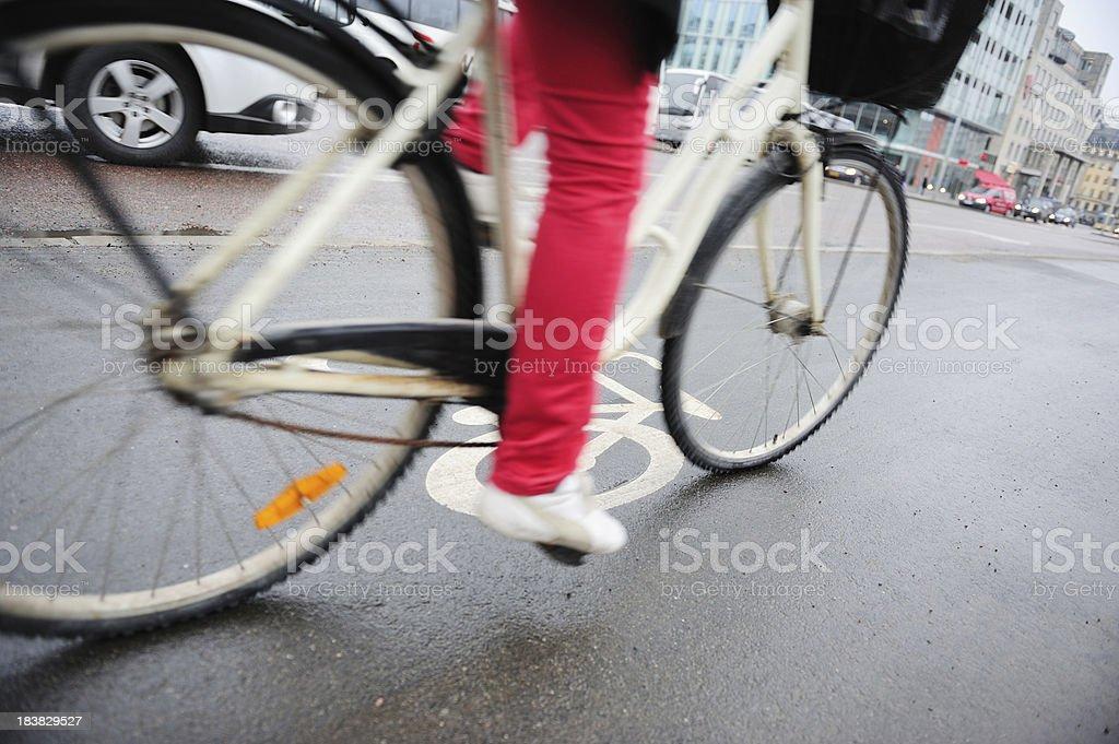 Woman on environment friendly bike stock photo
