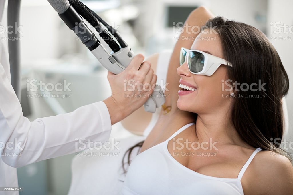 Woman on epilation treatment stock photo