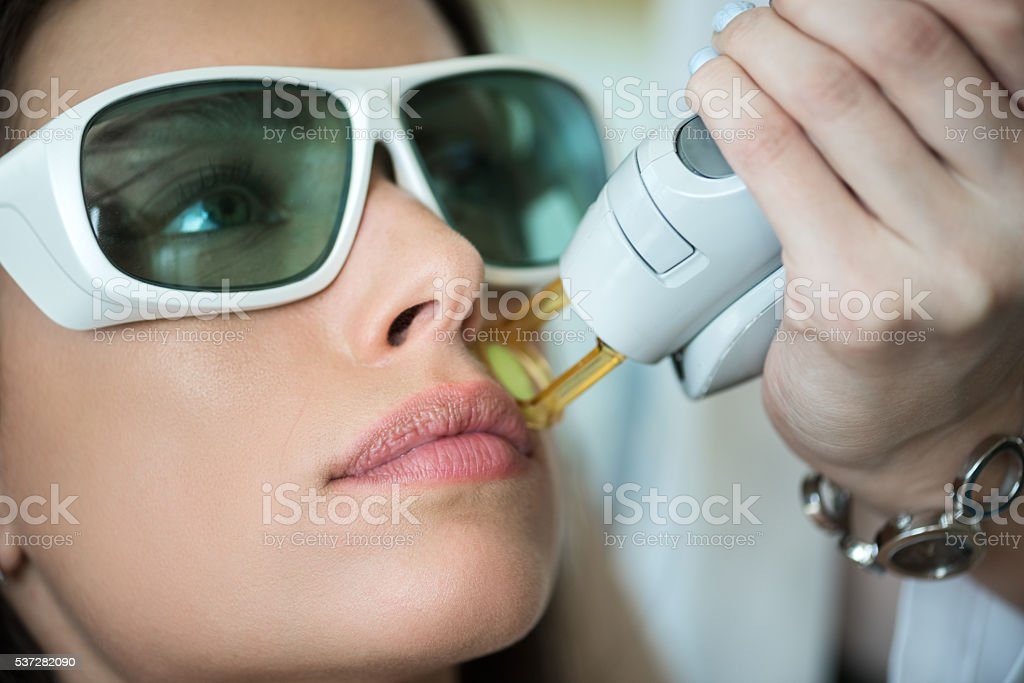 Woman on epilation treatment stock photo