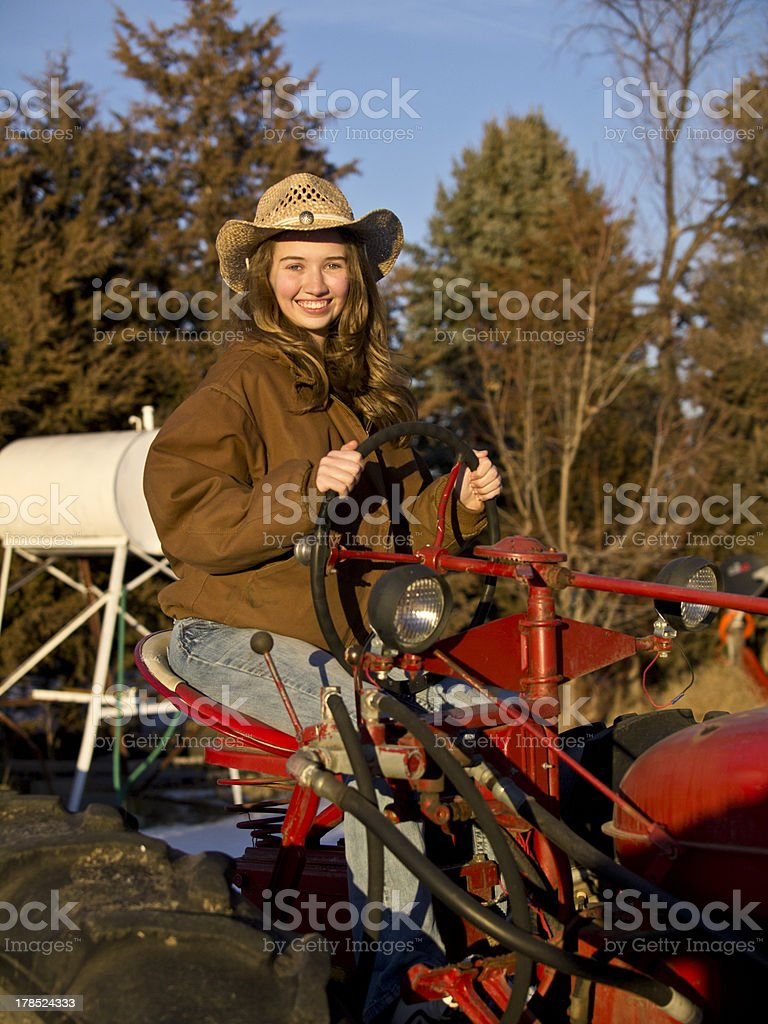 Woman on Farm Tractor royalty-free stock photo