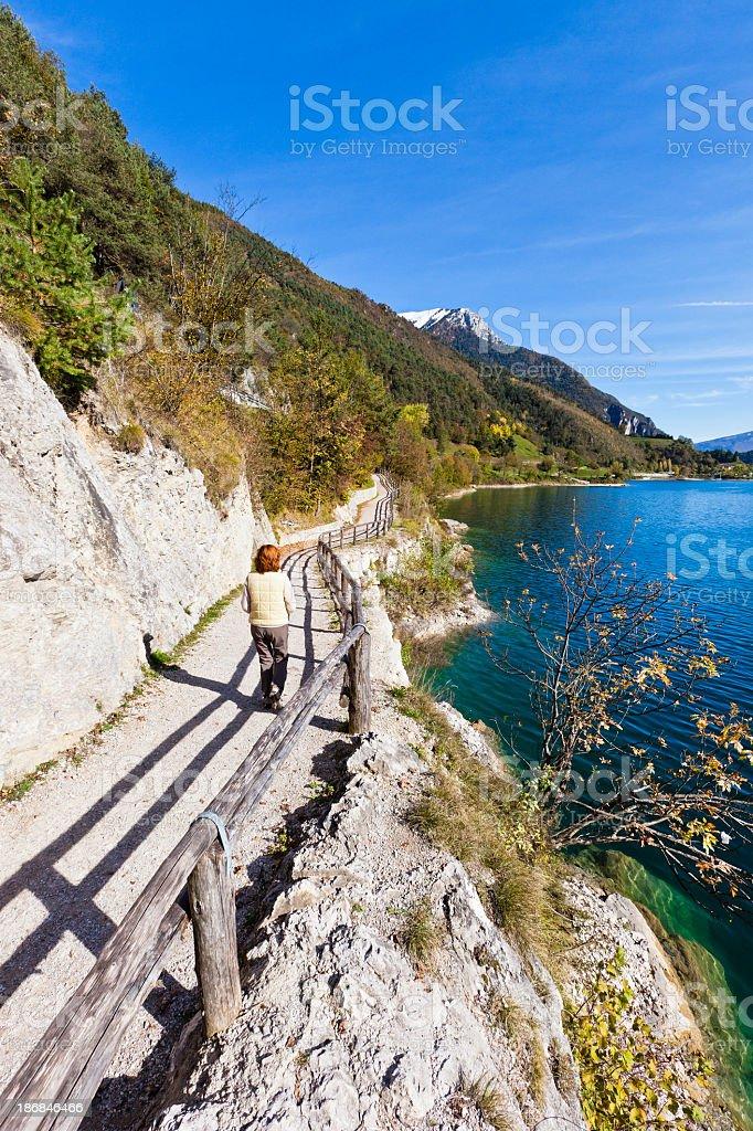 Woman On Footpath At Lake Ledro stock photo
