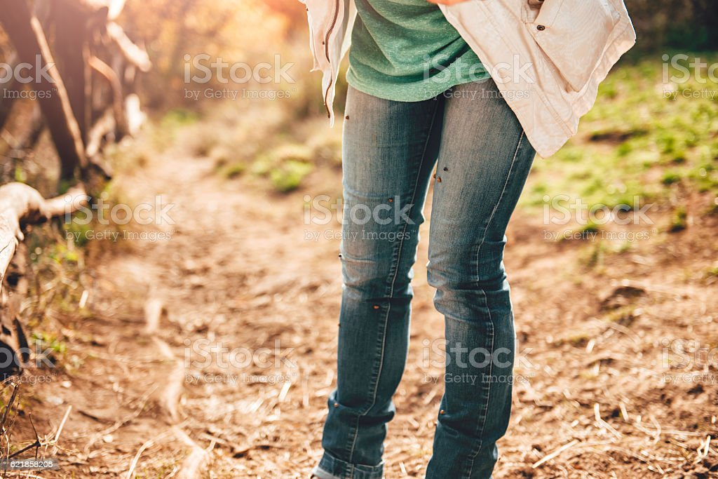 Woman on forest trail stock photo