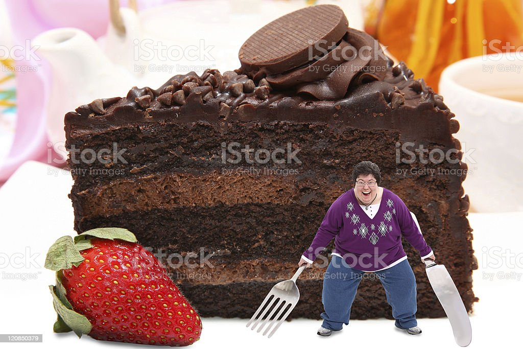Woman on Giant Plate of Chocolate Cake stock photo