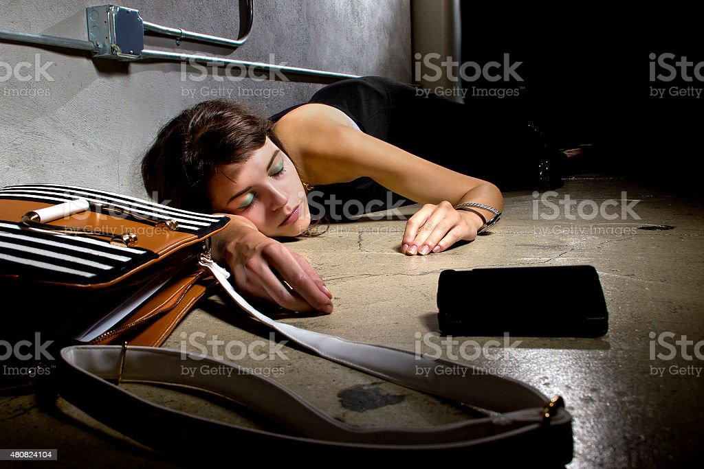 Woman On Ground Calling for Help stock photo
