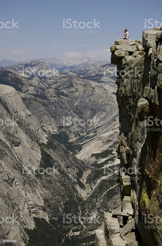 Woman on Half Dome stock photo