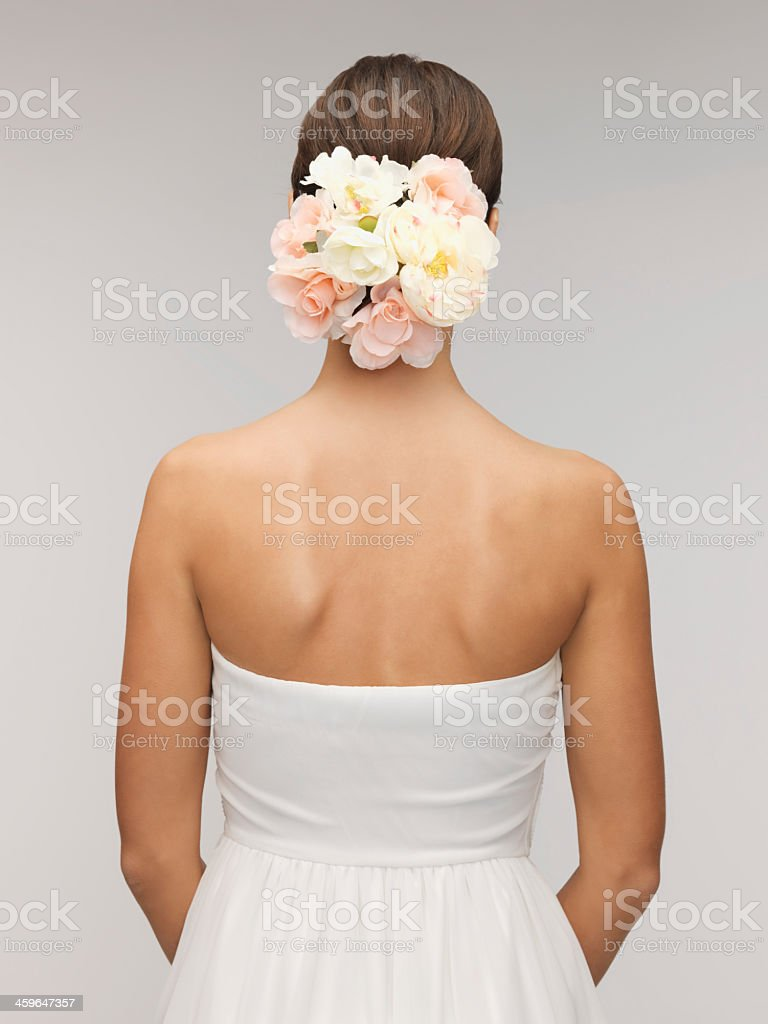 Woman on her wedding day with flowers in her hair stock photo