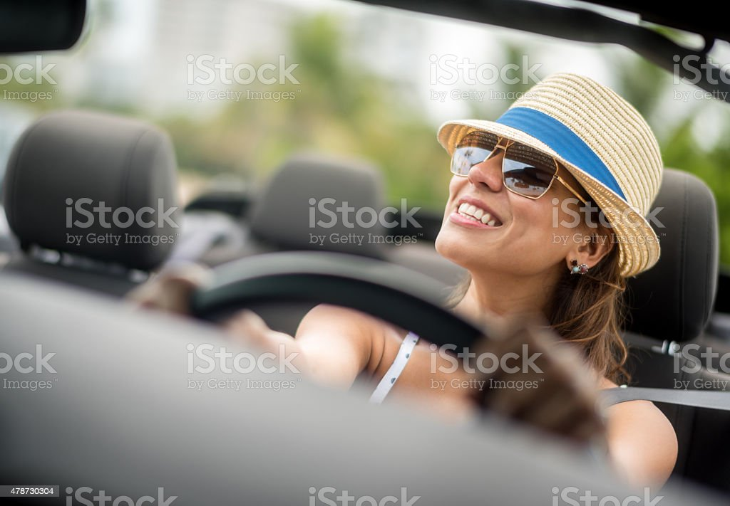 Woman on holidays driving a car stock photo
