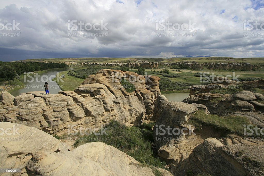 Woman on Hoodoos Above Milk River stock photo
