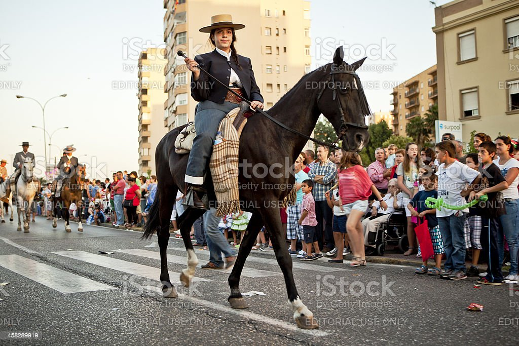 Woman on Horseback Marching in Andalusian Spring Parade royalty-free stock photo