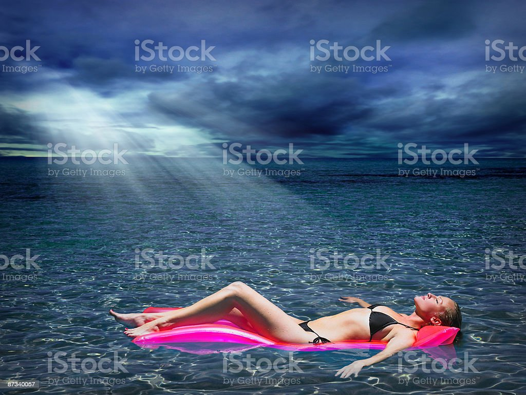 Woman on inflatable mattress in the sea royalty-free stock photo