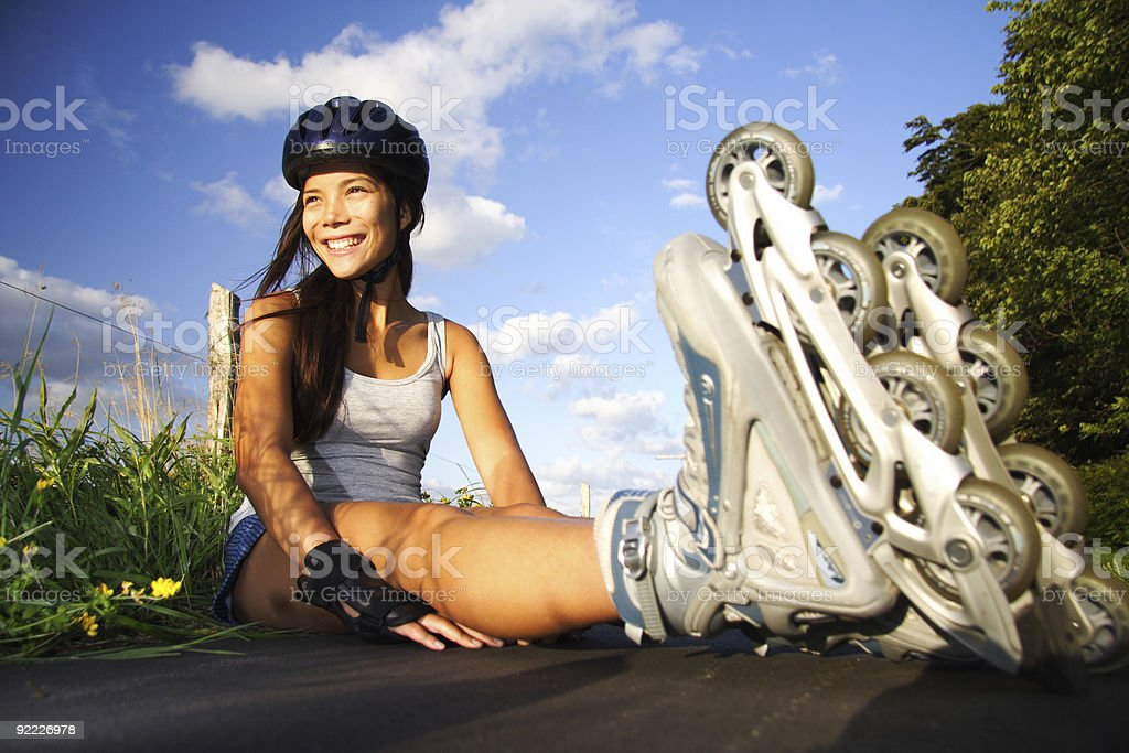 Woman on inline skates stock photo