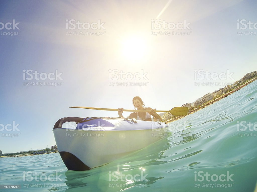 Woman on kayak in the sea during summer royalty-free stock photo