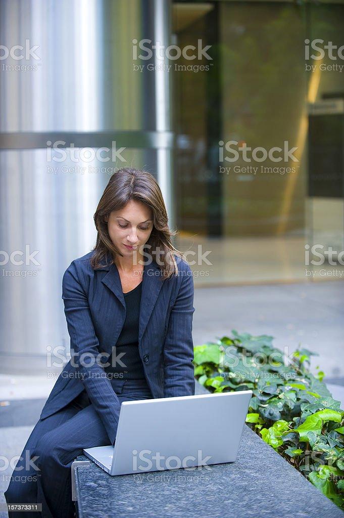 Woman on laptop outside royalty-free stock photo